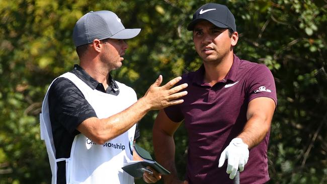 Luke Reardon will be Jason Day's full-time caddie — iof he can secure a US visa. Picture: Getty Images/AFP