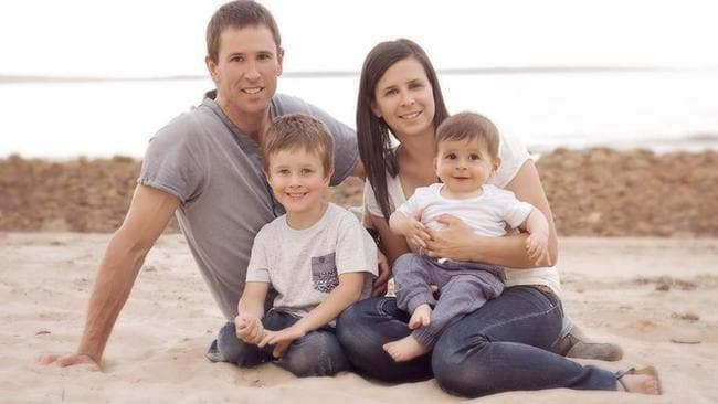 POIGNANT: Damien Little, Koda, 4, Melissa and baby Hunter enjoy a day at the beach in a photo released by the family.