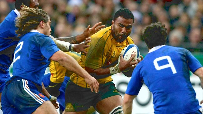 AUSTRALIA v France rugby union Test at Stade de France, north of Paris: Australia's Wycliff Palu, center, powers his way through Dimitri Szarewski. Picture: Michel Spingler
