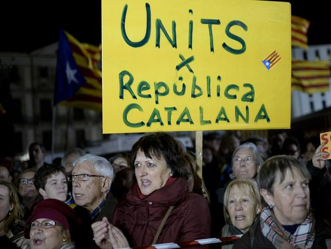 "Want independence ... Demonstrators hold placards reading in Catalan ""United for a Catalan Republic"" during a demonstration called by the Catalan National Assembly (ANC) demanding an agreement between secessionist parties in Barcelona. Picture: AFP"