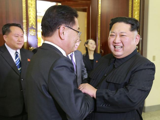 North Korean leader Kim Jong-un shakes hands with South Korean chief delegate Chung Eui-yong. Picture: KNCA/AFP