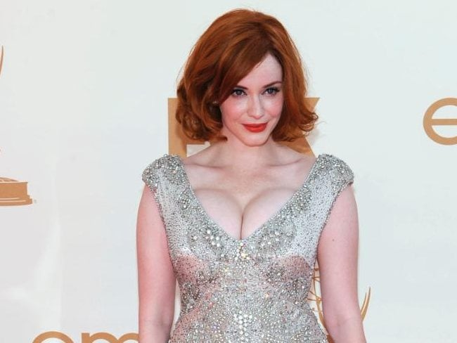 Turning heads... Christina Hendricks was bursting out of her dress at the Emmy Awards. Picture: Getty