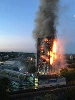 Flames and smoke coming from a 27-storey block of flats which is fully alight. The fire brigade said 40 fire engines and 200 firefighters battled the blaze. Picture: AFP Photo/Natalie Oxford