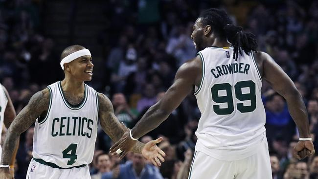 Boston Celtics guard Isaiah Thomas (4) is congratulated by Jae Crowder after a basket against the Washington Wizards.