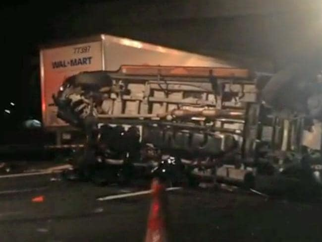 Accident scene ... Morgan's overturned limousine bus on the New Jersey Turnpike.