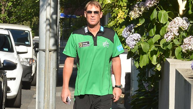 Shane Warne arrives at Cricket Australia headquarters to face charges from the MCG Big Bash league dispute. Picture: Jay Town