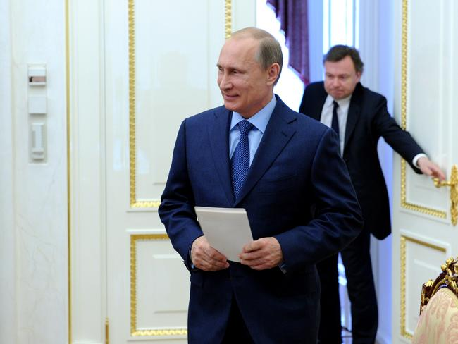 Blame game ... Russia's President Vladimir Putin has promised to do everything possible to influence pro-Russian separatists in eastern Ukraine and help ensure a full probe into the Malaysia Airlines crash last week. Picture: AFP PHOTO/ RIA-NOVOSTI/ POOL/ MIKHAIL KLIMENTYEV
