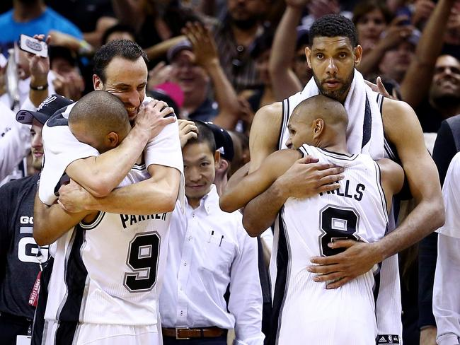 Spurs stars Manu Ginobili (L), Tony Parker (#9), Patty Mills (#8) and Tim Duncan celebrate their NBA championship win.