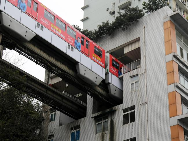 The train reportedly makes very little noise as it passes through the block of flats. Picture: VCG/Getty Images