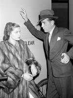 Humphrey Bogart and actress Lauren Bacall speak backstage while filming the 1946 film, The Big Sleep. Picture: AP