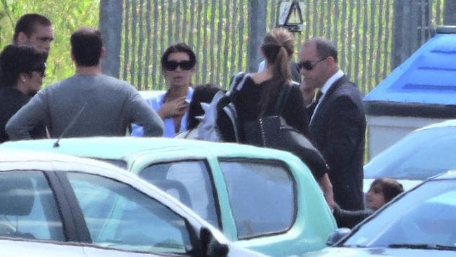 Kim steps off a private jet at Florence Airport ahead of her wedding, along with her 'Momager' Kris Jenner (left).