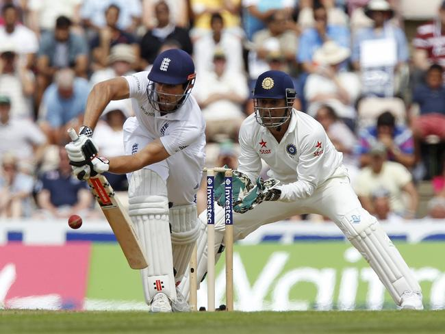 England's Captain Alastair Cook hits a shot watched by India's Captain MS Dhoni. Picture: AFP