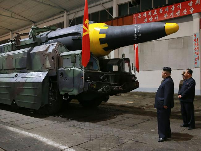 North Korean leader Kim Jong-un inspects a ground-to-ground medium long-range strategic ballistic rocket, Hwasong-12, at an undisclosed location. Picture: AFP/KCNA via KNS