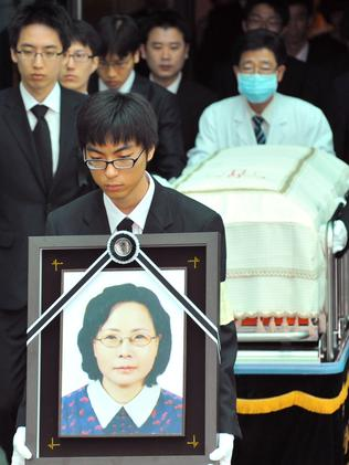 Relatives of Park Wang-Ja, who was killed at Mount Kumgang resort, carry her portrait and coffin during a funeral ceremony at Asan Hospital in Seoul on July 15, 2008. Picture: AFP/Kim Jae-Hwan