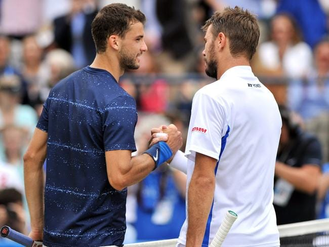 Dimitrov, left, shakes hands with Switzerland's Stan Wawrinka at the end of their encounter. Picture: Glyn Kirk