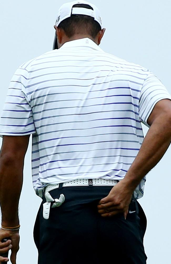 Tiger Woods grabs at his injured back during the second round.