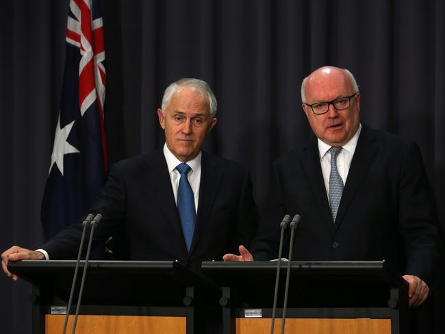 Prime Minister Malcolm Turnbull and Attorney-General George Brandis announced the amendments to the Racial Discrimination Act in Canberra today. Picture: Kym Smith