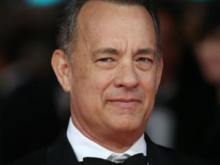US actor Tom Hanks arrives on the red carpet for the BAFTA British Academy Film Awards at the Royal Opera House in London on February 16, 2014. AFP PHOTO / ANDREW COWIE Picture: Afp