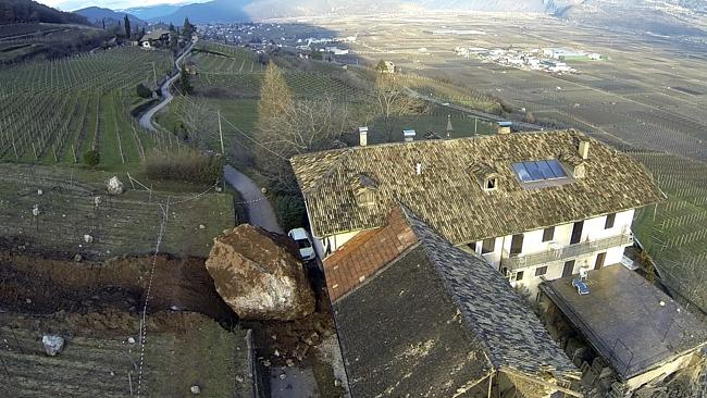 Near miss ... one boulder incredibly stopped just inches from the farm house. Pic: Markus Hell/Tareom.com.