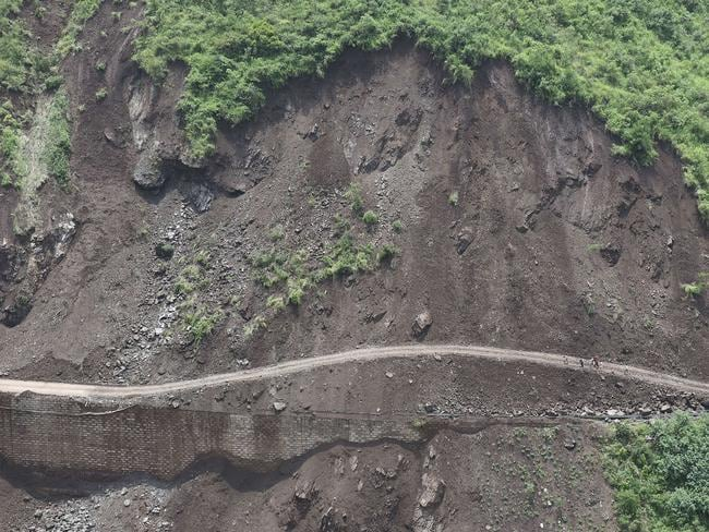 Earthquake... A landslide aftermath is pictured along a damaged road following an earthquake in Ludian county in Zhaotong, southwest China's Yunnan province. Picture: AFP