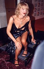 Classic Courtney Love in an artfully slashed dress at the 2000 Golden Globes. Not sure why she was even in this position on the red carpet. Picture: Jeff Kravitz/FilmMagic/Getty Images