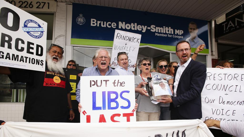 Greens MP David Shoebridge with Councillor Tony Bowen and residents at a snap anti-amalgamation protest last year. Picture: Justin Lloyd