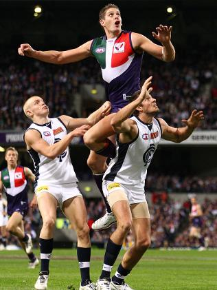 PERTH, AUSTRALIA - AUGUST 27: Aaron Sandilands of the Dockers flys for a      mark during the round 22 AFL match between the Fremantle Dockers and the      Carlton Blues at Subiaco Oval on August 27, 2010 in Perth, Australia.      (Photo by Paul Kane/Getty Images)