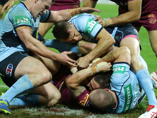 Queensland's Darius Boyd is help up over the line during State of Origin III.