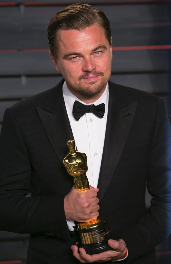 Golden boy Leonardo DiCaprio poses with his Best Actor award.