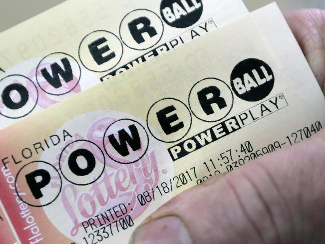 A customer shows his purchased Powerball tickets, Friday, Aug. 18, 2017, in Hialeah, Fla. An estimated $535 million for set for  Saturday night's drawing. (AP Photo/Alan Diaz)