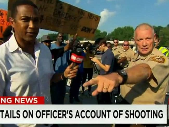 Internal review ... officer Dan Page allegedly shoved a CNN anchor in the middle of a live report from Ferguson. Picture: CNN