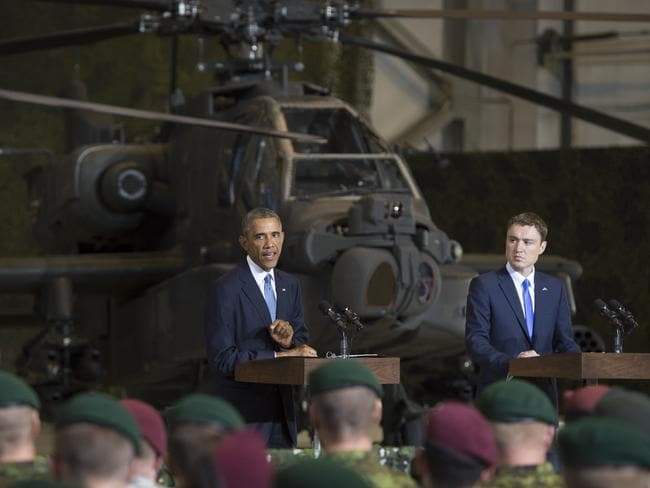 Symbolic visit ... US President Barack Obama speaks next to Estonian Prime Minister Taavi Roivas to US and Estonian members of the military at a hangar at Tallinn, Estonia.