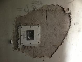 A damaged wall at Don Dale Juvenile Detention Centre