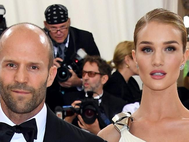 """NEW YORK, NY - MAY 02: Jason Statham (L) and Rosie Huntington-Whiteley attend the """"Manus x Machina: Fashion In An Age Of Technology"""" Costume Institute Gala at Metropolitan Museum of Art on May 2, 2016 in New York City.   Larry Busacca/Getty Images/AFP == FOR NEWSPAPERS, INTERNET, TELCOS & TELEVISION USE ONLY =="""