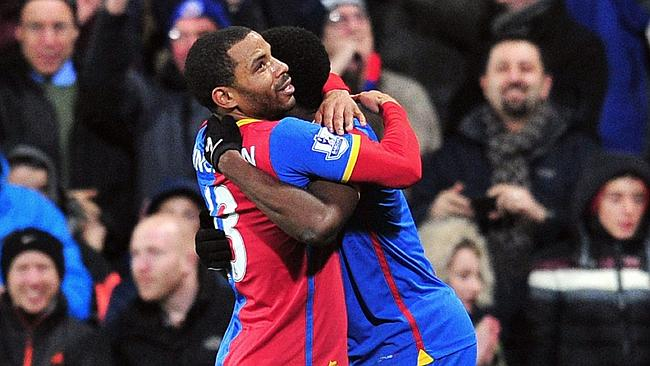 Crystal Palace's English midfielder Jason Puncheon gives away a free hug.