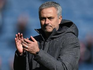 Manchester United's Portuguese manager Jose Mourinho applauds after the English Premier League football match between Burnley and Manchester United at Turf Moor in Burnley, north west England on April 23, 2017. / AFP PHOTO / OLI SCARFF / RESTRICTED TO EDITORIAL USE. No use with unauthorized audio, video, data, fixture lists, club/league logos or 'live' services. Online in-match use limited to 75 images, no video emulation. No use in betting, games or single club/league/player publications. /