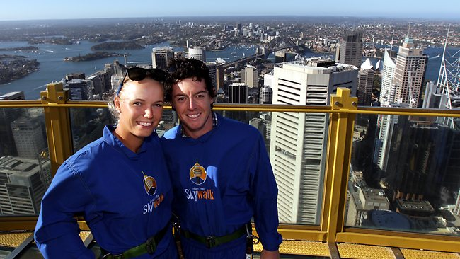 TOP of the world: Caroline Wozniacki and golfing superstar boyfriend Rory McIlroy on Sydney Tower Sky Walk in January. Picture: Stephen Cooper