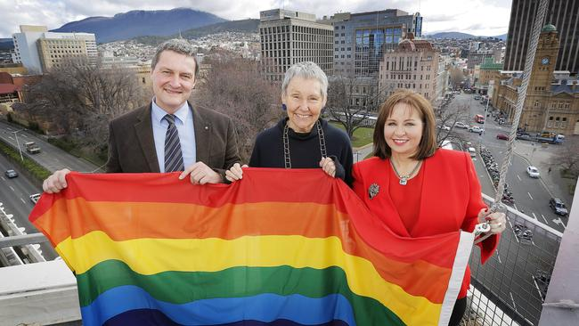 Marriage equality campaigner Rodney Croome, left, Susan Bitter from Working It Out, and Hobart Lord Mayor Sue Hickey raising the rainbow flag over the Hobart Council Centre Building last month. Picture: MATHEW FARRELL