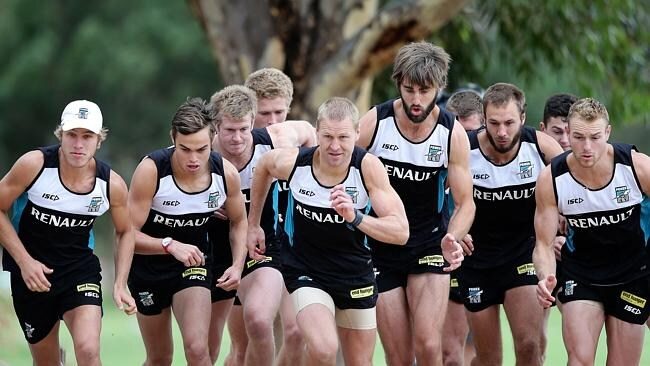 Port Adelaide resume full training at the University oval. Kane Cornes (centre) showing the way in the time trial. Picture: Sarah Reed