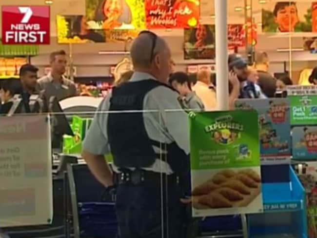 Police and staff inside the supermarket. Picture: Seven News