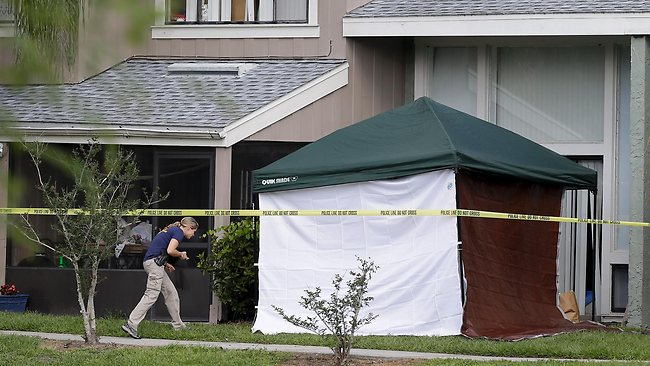 An FBI investigator walks to the apartment where a man was shot by an FBI agent in Orlando, Fla. The FBI says the man, being questioned by authorities in the Boston bombing probe, was fatally shot when he initiated a violent confrontation. Picture: John Raoux
