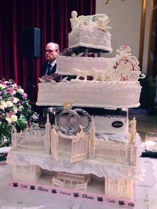 The elaborate multi-tiered wedding cake ... Playboy cover girl, bunny and model Cathy Schmitz, 24, married billionaire Richard Lugner, 81. Picture: Cathy Schmitz / Facebook