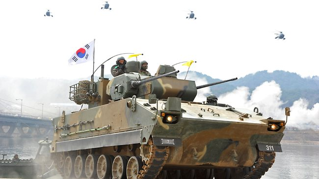 South Korean anti-aircraft armoured vehicles move over a temporary bridge during a river-crossing military drill in Hwacheon near the border with North Korea.