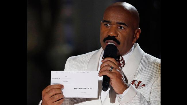 Steve Harvey holds up the card showing the winners after he incorrectly announced Miss Colombia Ariadna Gutierrez as the winner at the Miss Universe pageant. Picture: John Locher/AP Photo.