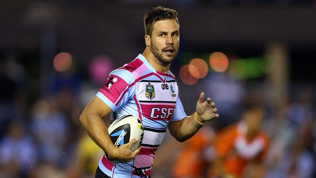 Beau Ryan of the Sharks makes a break during the round 10 NRL match between the Cronulla-Sutherland Sharks and the Wests Tigers at Remondis Stadium on May 17, 2014 in Sydney, Australia.
