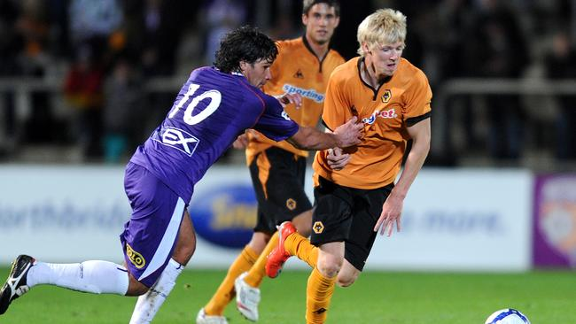 Keogh, right, in his Wolves days, playing against Glory in a friendly.