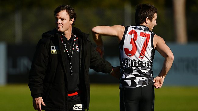Coach Scott Watters talks with Stephen Milne. Picture: Colleen Petch
