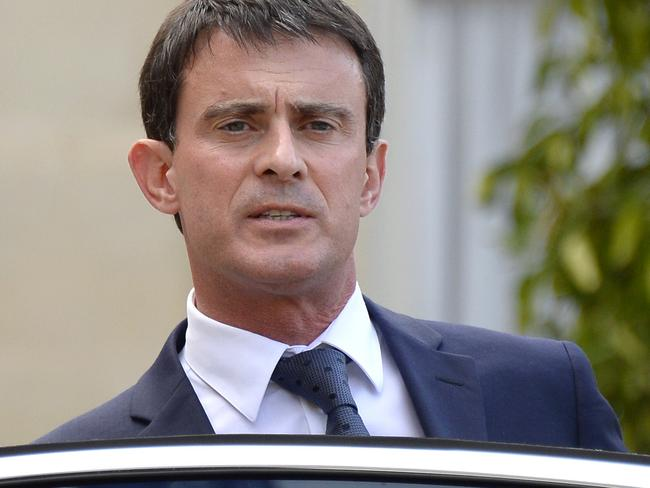 Political response ... French Prime Minister Manuel Valls leaves the Elysee Palace in Paris after meeting with the French president and his cabinet regarding an Air Algerie plane.