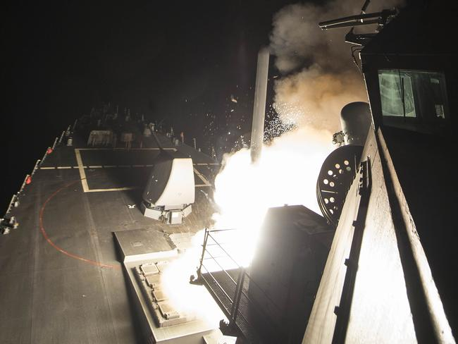 In this image released by the US Navy, the USS Ross fires a tomahawk land attack missile at a Syrian air force airfield . Picture: AFP