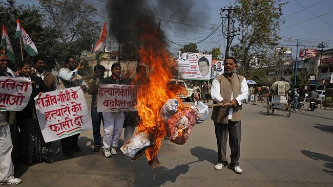 India's ruling Congress party supporters burn an effigy of Tamil Nadu state chief ministe